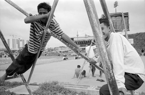 CAMBODIA. Phnom Penh. 5/12/1999: Being 20 in Phnom Penh. Spectator of basket-ball matches at Olympic Stadium.