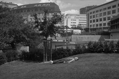 BELGIUM. Brussels. 23/06/2012: Taking a nap behind Saint Maria Magdalena church.