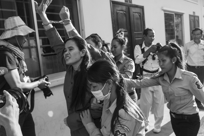 CAMBODIA, Phnom Penh. 22/01/2015: Phan Chunreth, a land rights activists who was arrested mid-november during a land issue protest and sentenced to 1 year in jail greets supporters gathered outside the Appeals Court.